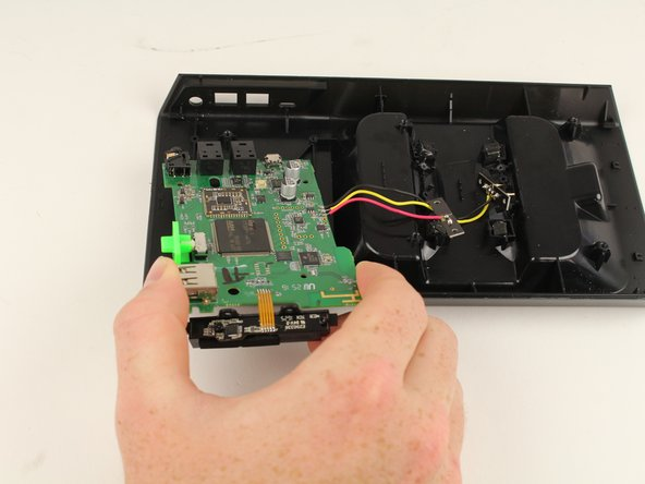 Lift up the motherboard from the base station and pull it away from the device to remove it.