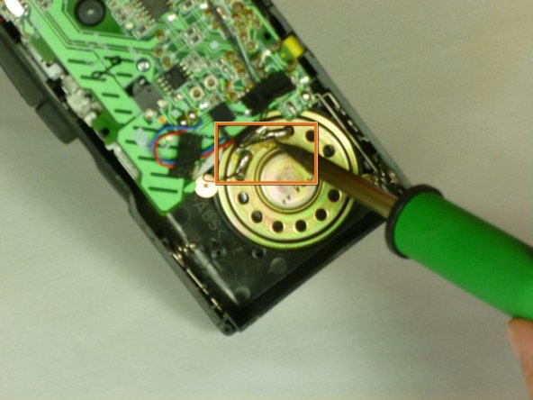 Image 2/2: If the replacement speaker has no wire, desolder the old wire where it connects to the broken speaker.