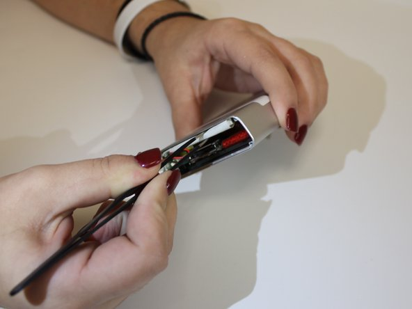 If the battery is still malfunctioning, carefully unplug the battery using tweezers.