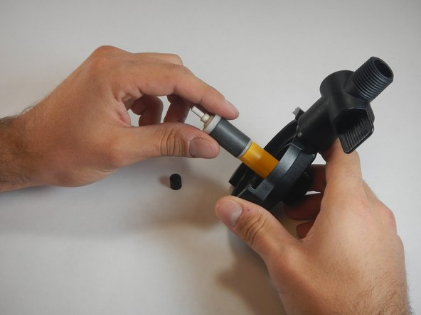 Hold the impeller cover with one hand and the impeller with the other. Slide the impeller out.