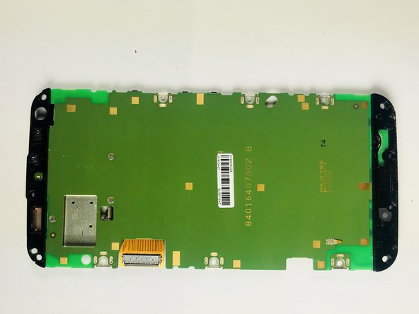 Use the metal spudger and lift the back cover on the bottom side of the phone (this is attached to the motherboard).