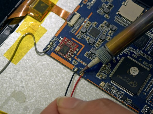 Use soldering gun to remove the positive and negative wires connecting the battery to the circuit board.