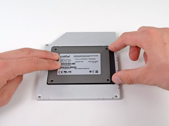 Reconnect any cables you have removed from the original optical drive onto the optical bay enclosure.