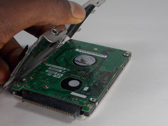 Image 2/2: Lift the frame to remove if from the hard drive.