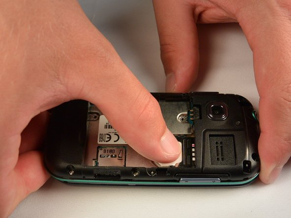 Using your finger, push the SIM Card down and slide out of the slot.