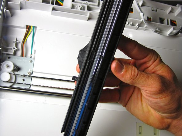 Remove black component by gently pulling it up from the black scanner belt.