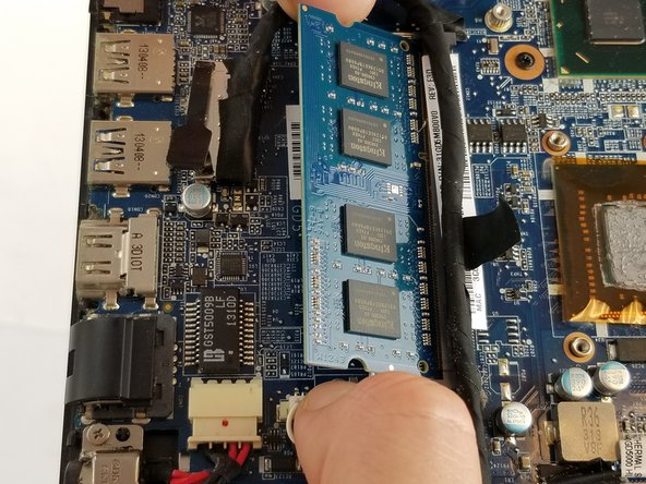 When the RAM is sprung up, pull it out  in the same direction it is currently at, to remove it from the lab top.