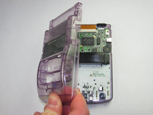 Gently lift and separate the back housing from the rest of the device.  Now you've got the back housing out!