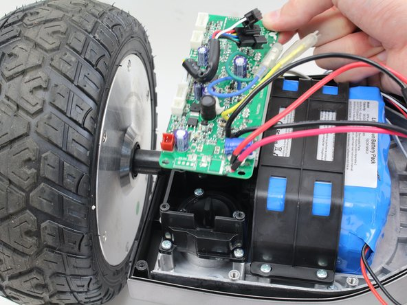 Remove the circuit board by pulling it up and out of the hoverboard.