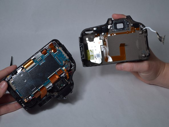 Image 3/3: If you are only replacing the camera back, stop here and reverse the preceding steps to install the new back.