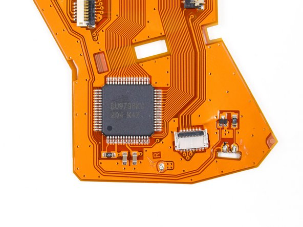 Image 3/3: The IC on the large ribbon cable is a ROHM [http://www.rohm.com/web/global/products/-/product/BU9798KV|BU9798KV] multifunction LCD segment driver. Moving on...