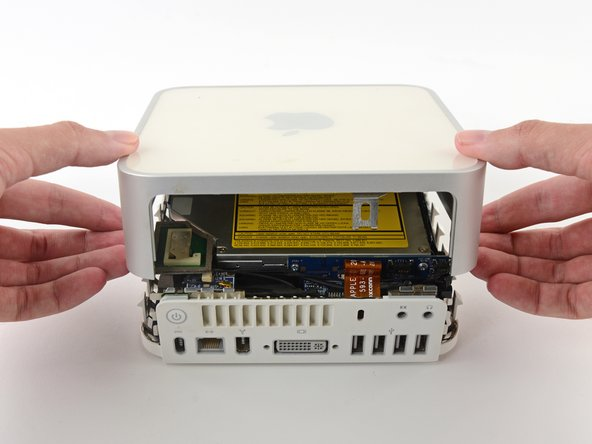 Flip the Mac Mini back over and lift the top housing off of the lower housing.