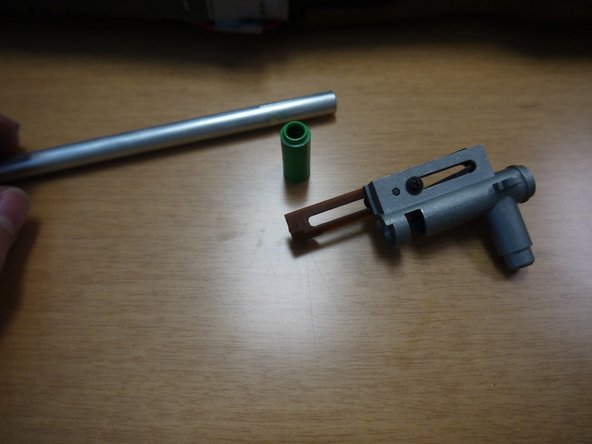 Image 1/3: Slide the inner barrel into the hop-up unit, and replace the plastic clip that holds the barrel in place, as well as the ring that slides onto the front of the hop-up unit.