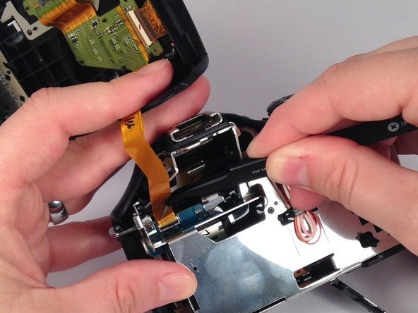 Gently but forcefully lift up on the parallel cable connecting the two halves of the camera.