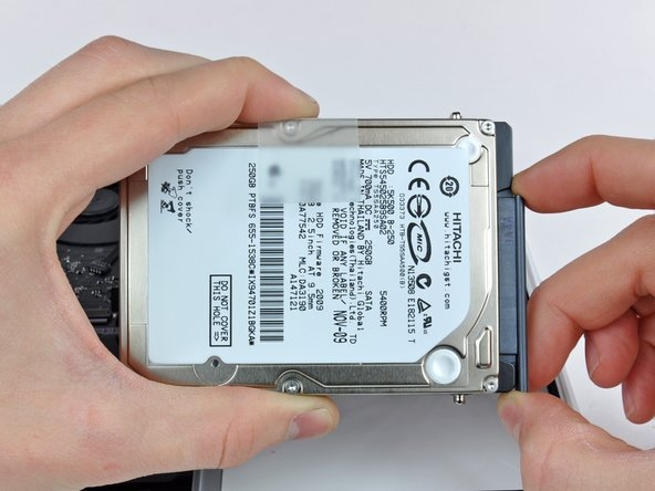 Image 1/2: Remove the hard drive cable by pulling its connector straight away from the hard drive.