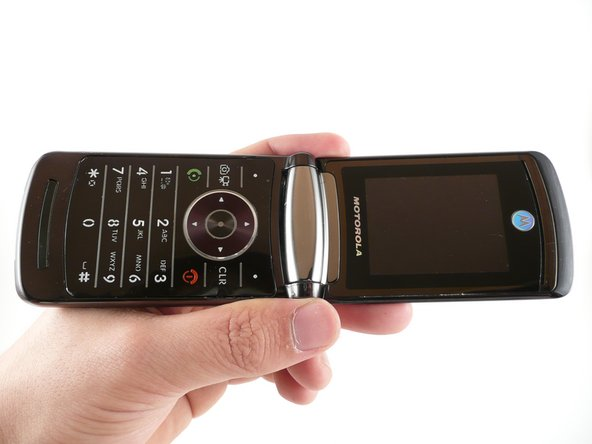 Flip open the RAZR2 with the keypad and main LCD facing you.