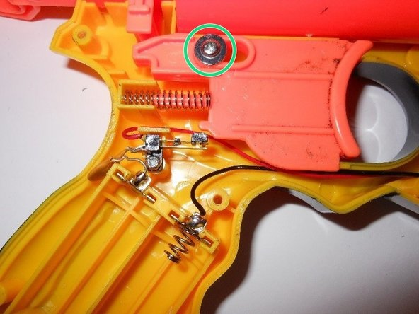 Remove the phillips head, 10.2 mm screw holding the trigger in place.