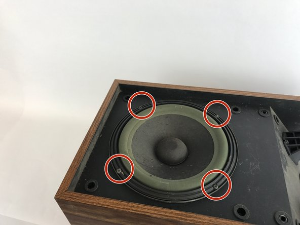 Lay the speaker body on its back.