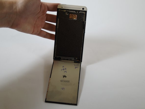 Image 2/2: The screen will stay on a hinge until the final step.