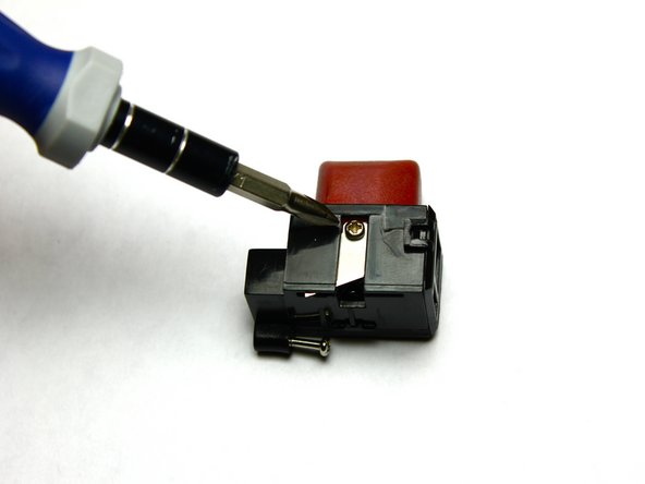 Use Phillips #00 screw to unscrew blade from blade cutter
