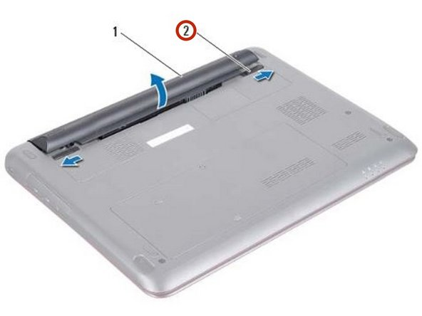 Ensure that the two battery release latches are in locked position.