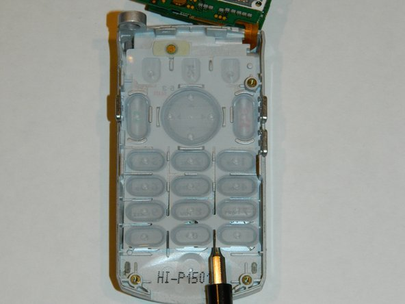 While avoiding contact with the inner electronics, use the spudger to lift the plastic keypad from the phone.