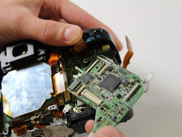 Remove motherboard by gently lifting out with fingers