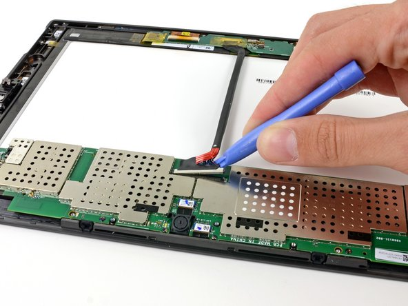 Image 1/2: We disconnect the display and digitizer cable from the motherboard with the help of a [product|IF145-000|plastic opening tool].