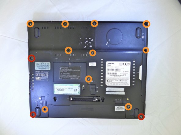 Remove the three 17mm screws found on the backside of the laptop using a #00 phillips head screwdriver.