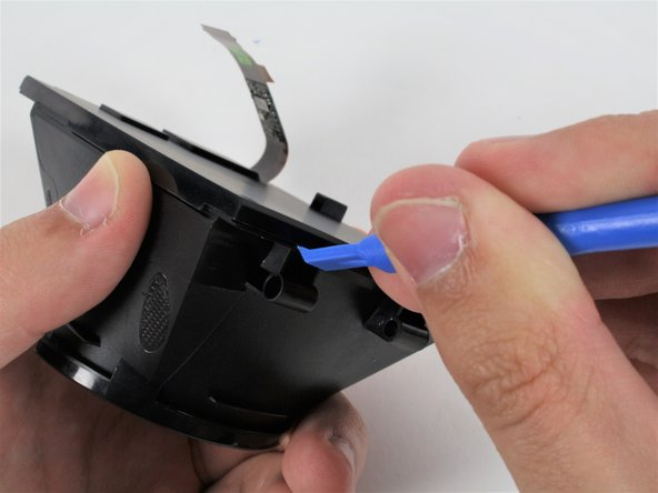 Gently pull the screen cover away from the eyepiece housing, threading the ribbon cable through the hole.