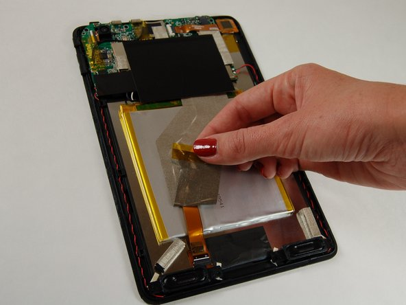 Start by placing tablet face down and carefully removing the mesh wire tap from the back of the battery.