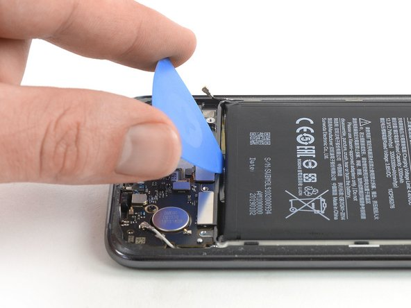 Use an opening pick to pry the battery out of its recess until you can get a good grip.