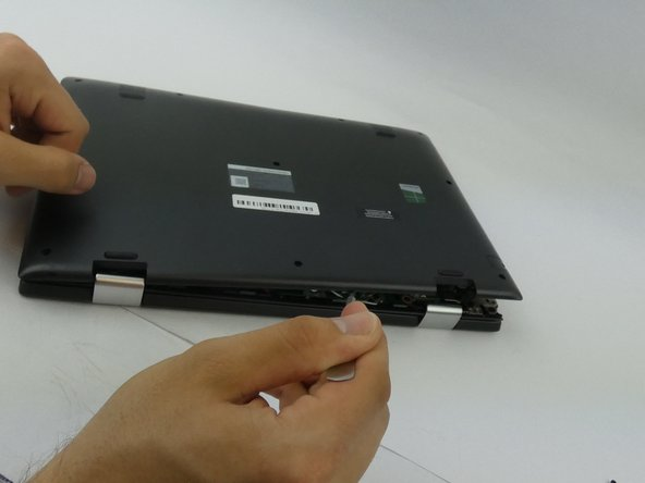 Insert the spudger into the groove work your way around the laptop to separate the bottom from the case.