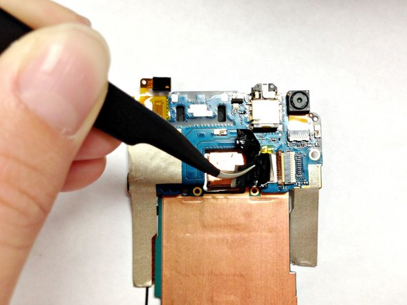 Use the tweezers to carefully peel back the copper tape attached to your rear camera.