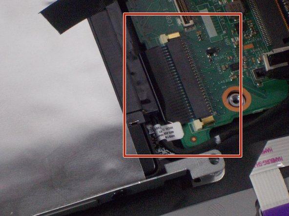 Remove the no - fuss ribbon connector which connects the Solid State Drive to the motherboard.