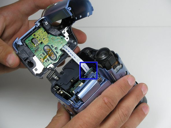 Using your fingers, carefully pull the ribbon cable away from the logic board.