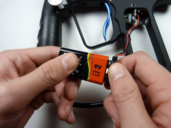 Remove the 9V battery by unsnapping it.