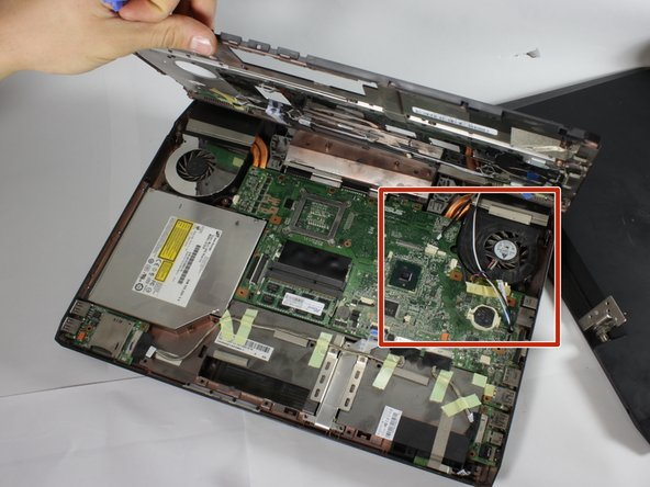 Lift the black cover off, revealing the motherboard, fans and other components.