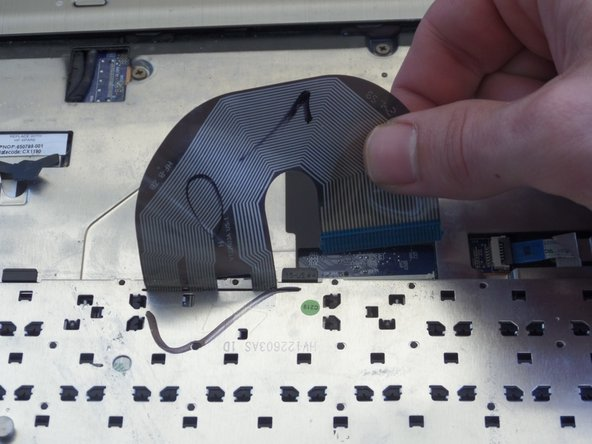 Pull  ribbon cable up away from keyboard to completely remove.
