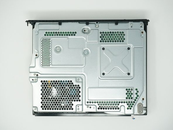 Use a Torx T9 screwdriver to remove the six 47mm long screws, which attach the bottom side of the outer case.