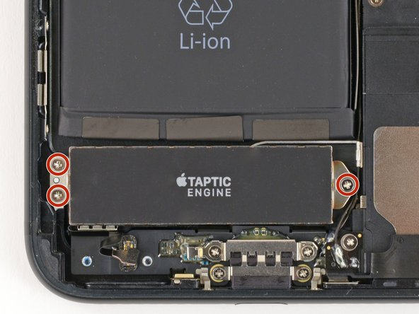Remove the three 1.5 mm Phillips screws securing the Taptic Engine to the rear case.
