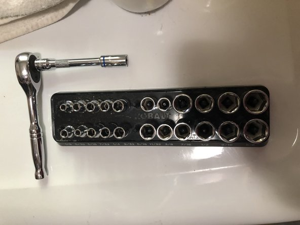 Have your 1/4-inch drive ratchet ready for the following step.