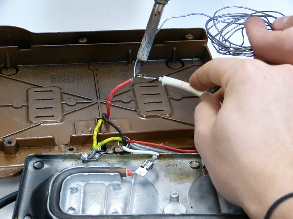 Solder the other part on to the red cable as shown in the picture.