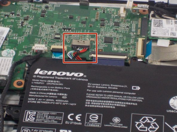 Locate the multicolored power cables coming directly from the top of the battery and into the motherboard.