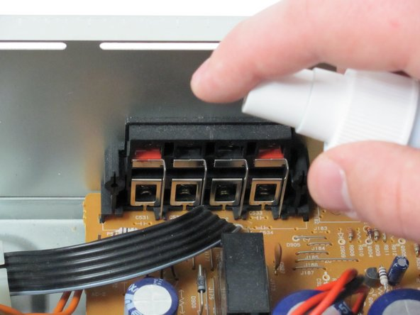 Lightly spray the input and output connectors with DeoxIT on the inside of the back panel.