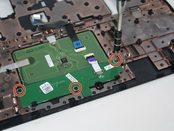 Use a Phillips #0 screwdriver to unscrew the three 4mm screws from the touchpad buttons on the back of the palmrest.