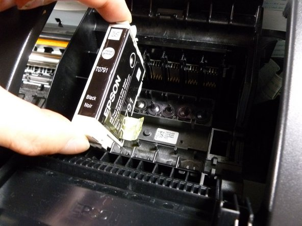Grab the sides of the ink cartridge and pull it out.