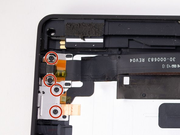 Remove the four 2.3mm T5 Torx screws from the micro USB port and power button assembly.