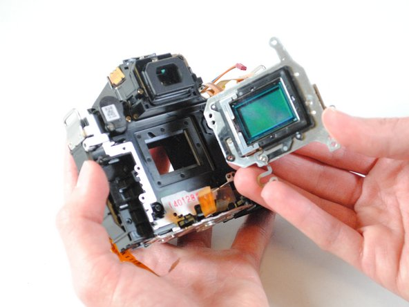 Using your fingers, lift the image sensor from the device.