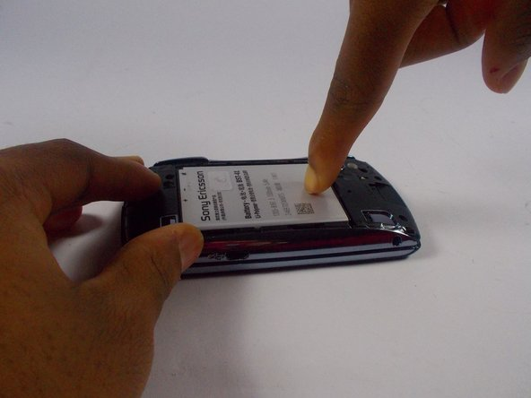 Lightly press the battery into the phone so that it is secure.